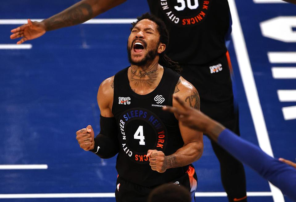 May 26, 2021; New York, New York, USA; New York Knicks guard Derrick Rose (4) reacts against the Atlanta Hawks during the second half of game two of the Eastern Conference quarterfinal at Madison Square Garden. Mandatory Credit: