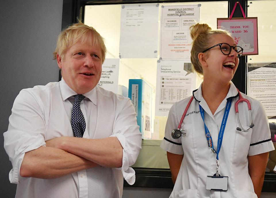 MANSFIELD, ENGLAND - NOVEMBER 08: Prime Minister Boris Johnson talks with a physiotherapist as he meets nursing staff during a general election campaign visit to King's Mill NHS Hospital in Mansfield on November 8, 2019 in Nottinghamshire, United Kingdom. (Photo by Daniel Leal-Olivas - WPA Pool/Getty Images)