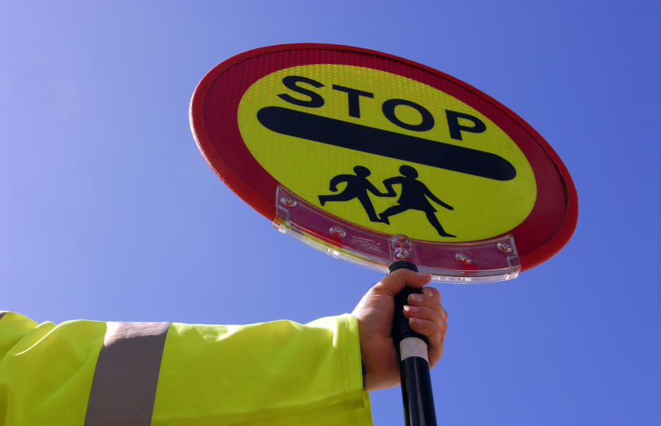 School crossing patrol UK. (Photo by Photofusion/Universal Images Group via Getty Images)