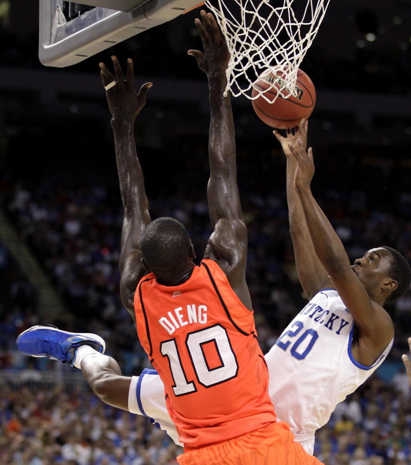 Kentucky guard Doron Lamb (20) shoots over Louisville center Gorgui Dieng (10) during the first half of an NCAA Final Four semifinal college basketball tournament game Saturday, March 31, 2012, in New Orleans. (AP Photo/Mark Humphrey)