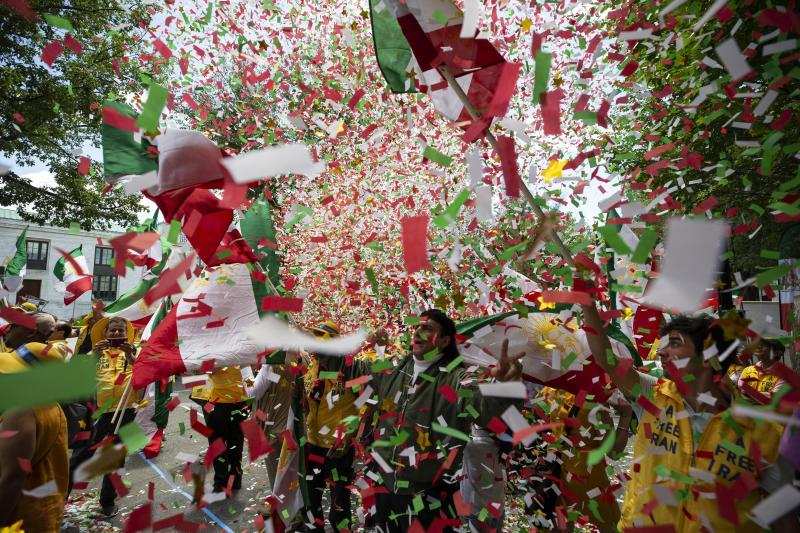 Confetti fills the air as activists gather at the State Department before a march to the White House to call for regime change in Iran, Friday, June 21, 2019, in Washington. (AP Photo/Alex Brandon)