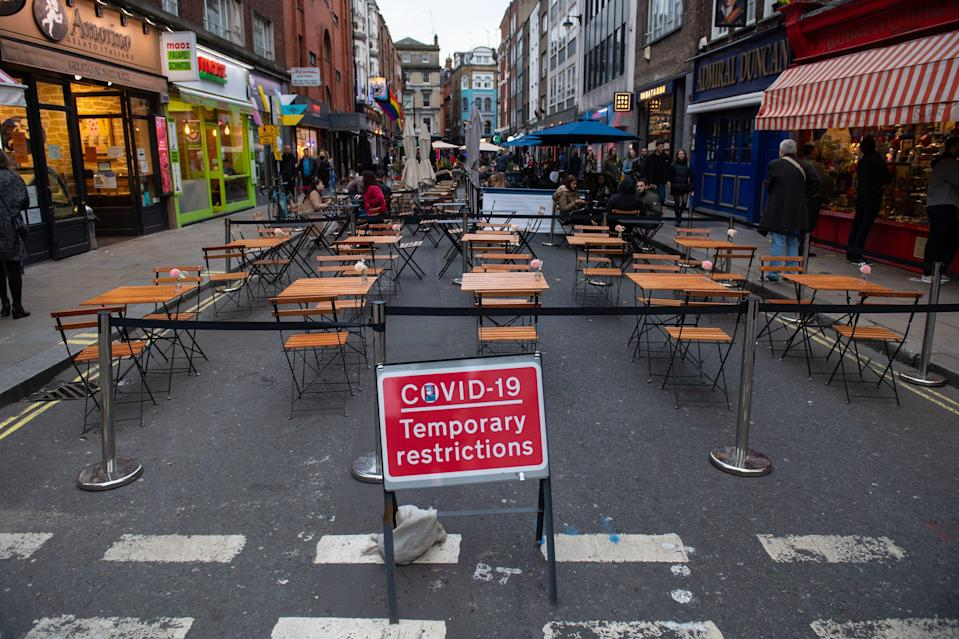 Covid 19 signage in Soho, London, on the first day after the city was put into Tier 2 restrictions to curb the spread of coronavirus (PA)