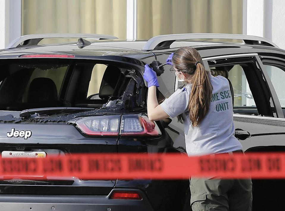 A forensic technician works on the vehicle authorities say officers shot at after the driver, later identified as Hannah Roemhild, breached security at President Donald Trump's Mar-a-Lago resort in Palm Beach on Jan. 31, 2020.