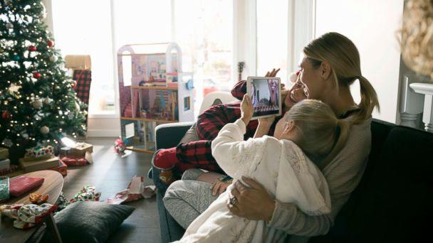 PHOTO: This stock photo depicts a mom with her children on Christmas morning. (STOCK/Getty Images)