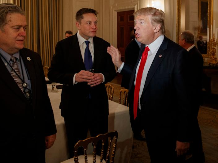 Elon Musk is pictured alongside President Donald Trump at the White House on February 3, 2017.