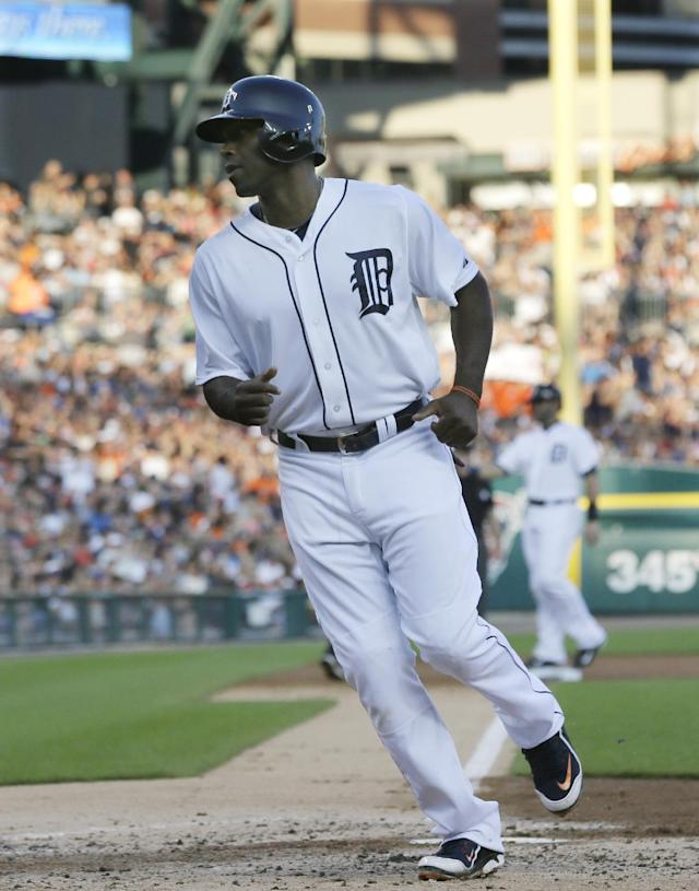 Detroit Tigers' Torii Hunter scores on a bases loaded walk to teammate Austin Jackson during the second inning in the second baseball game of a doubleheader against the Cleveland Indians, Saturday, July 19, 2014 in Detroit. (AP Photo/Carlos Osorio)
