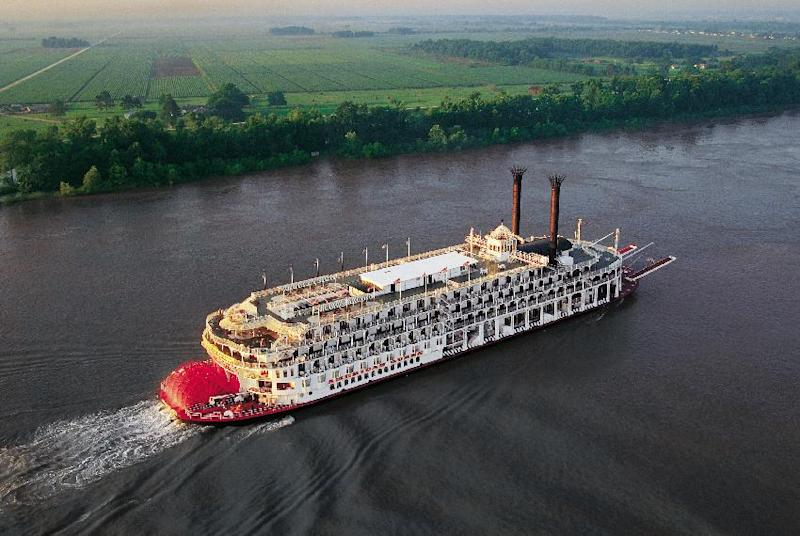 This image from the mid-1990s provided by the Great American Steamboat Company shows the American Queen riverboat on the Mississippi River outside New Orleans. The ship last sailed the Mississippi and Ohio rivers in 2008 but resumes riverboat cruising in late April following a multi-million dollar refurbishment. (AP Photos/Great American Steamboat Company)