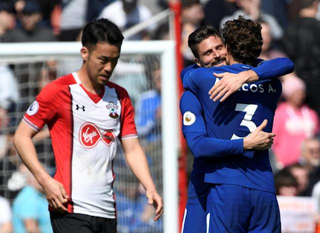 """Soccer Football - Premier League - Southampton vs Chelsea - St Mary's Stadium, Southampton, Britain - April 14, 2018 Chelsea's Olivier Giroud and Marcos Alonso celebrate as Southampton's Maya Yoshida looks dejected after the match Action Images via Reuters/Tony O'Brien EDITORIAL USE ONLY. No use with unauthorized audio, video, data, fixture lists, club/league logos or """"live"""" services. Online in-match use limited to 75 images, no video emulation. No use in betting, games or single club/league/player publications. Please contact your account representative for further details."""