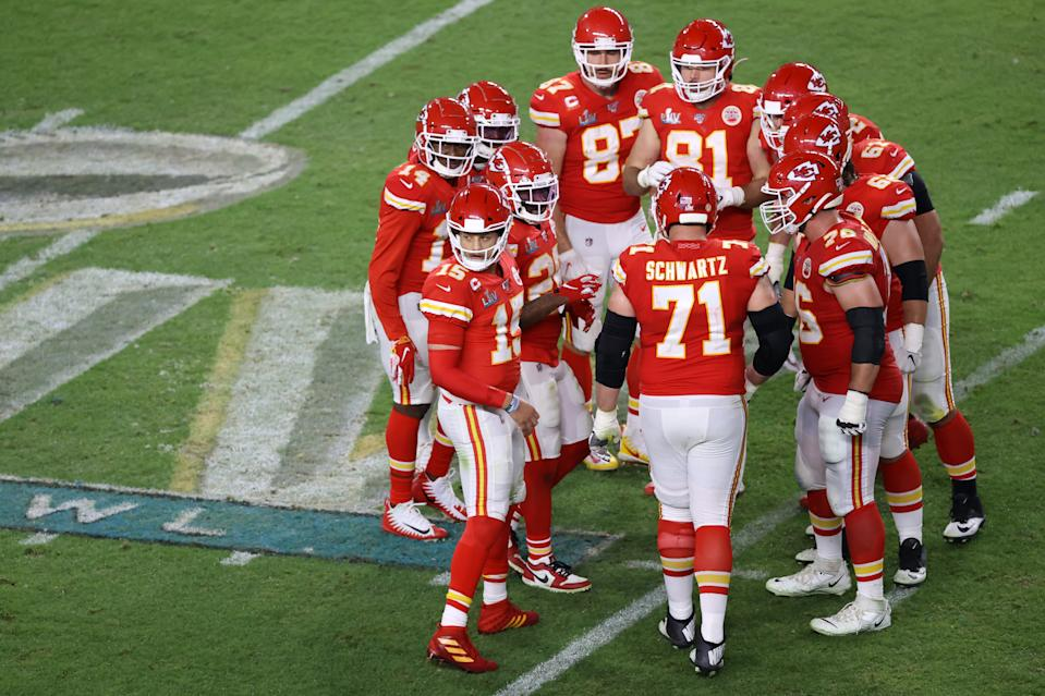 MIAMI, FLORIDA - FEBRUARY 02: Patrick Mahomes #15 of the Kansas City Chiefs huddles with teammates against the San Francisco 49ers during the fourth quarter in Super Bowl LIV at Hard Rock Stadium on February 02, 2020 in Miami, Florida. (Photo by Elsa/Getty Images)