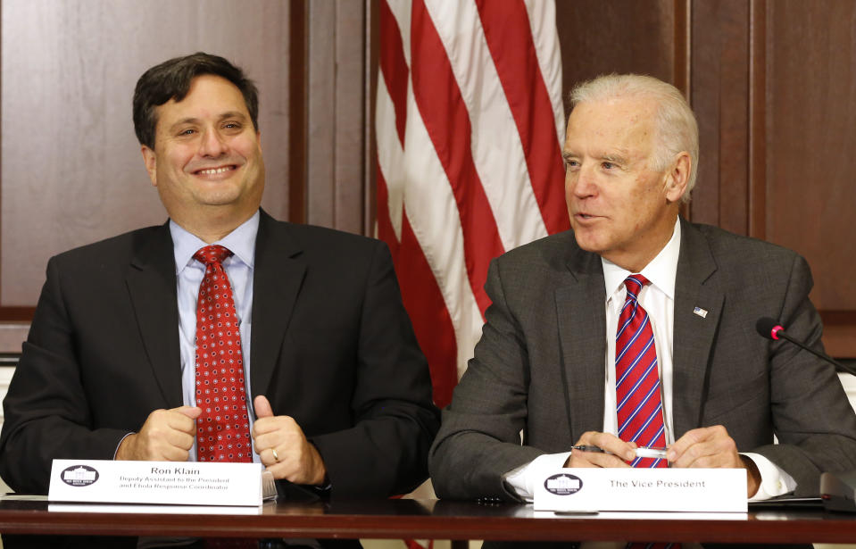 U.S. Vice President Joe Biden (R) is joined by Ebola Response Coordinator Ron Klain (L) while he speaks with organization leaders that are responding to the Ebola crisis, while in the Eisenhower Executive Office Building on the White House complex in Washington, November 13, 2014.        REUTERS/Larry Downing   (UNITED STATES - Tags: POLITICS HEALTH)