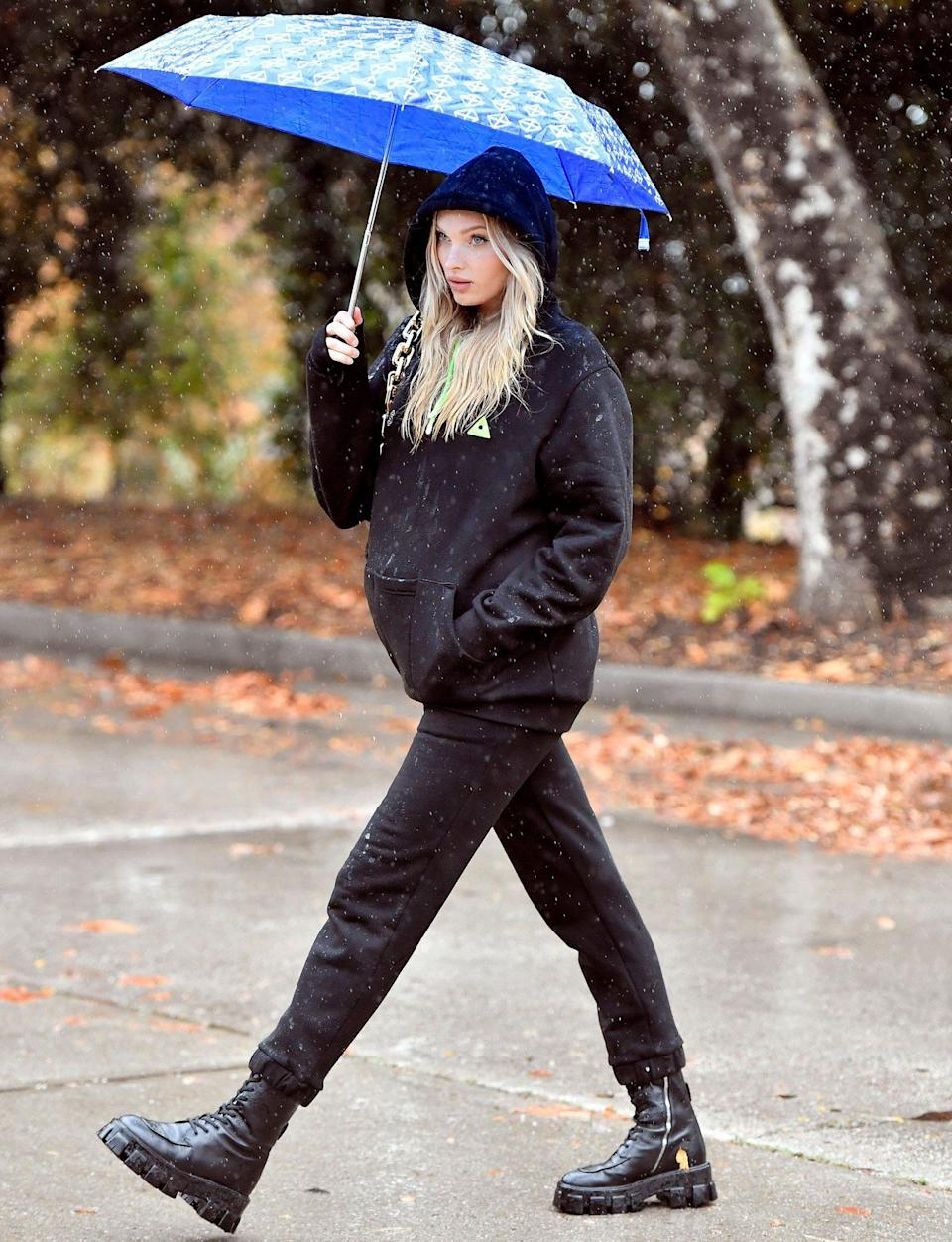 <p>Model mom-to-be Elsa Hosk takes a walk in the rain in Los Angeles on Monday.</p>
