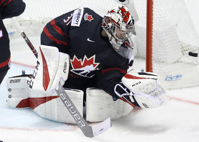 Canada's goaltender Carter Hart makes a save during the Ice Hockey World Championships group A match between Canada and France at the Steel Arena in Kosice, Slovakia, Thursday, May 16, 2019. (AP Photo/Petr David Josek)