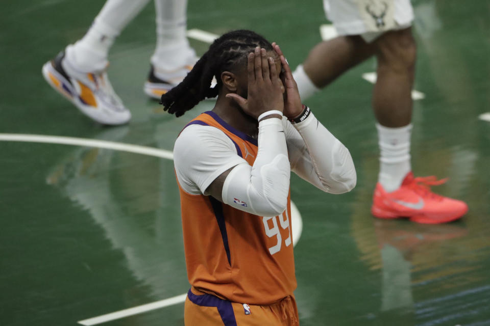 Phoenix Suns forward Jae Crowder (99) reacts during the second half against the Milwaukee Bucks in Game 4 of basketball's NBA Finals Wednesday, July 14, 2021, in Milwaukee. (AP Photo/Aaron Gash)