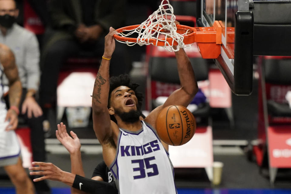 Sacramento Kings forward Marvin Bagley III (35) dunks during the first quarter of an NBA basketball game against the Brooklyn Nets, Tuesday, Feb. 23, 2021, in New York. (AP Photo/Kathy Willens)