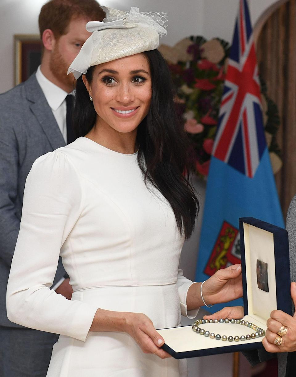 The Duchess donned the sparkling piece of bling gifted to her by Prince Charles while visiting President Jioji Konrote and First Lady Faga Sarote in Fiji. Photo: Getty Images