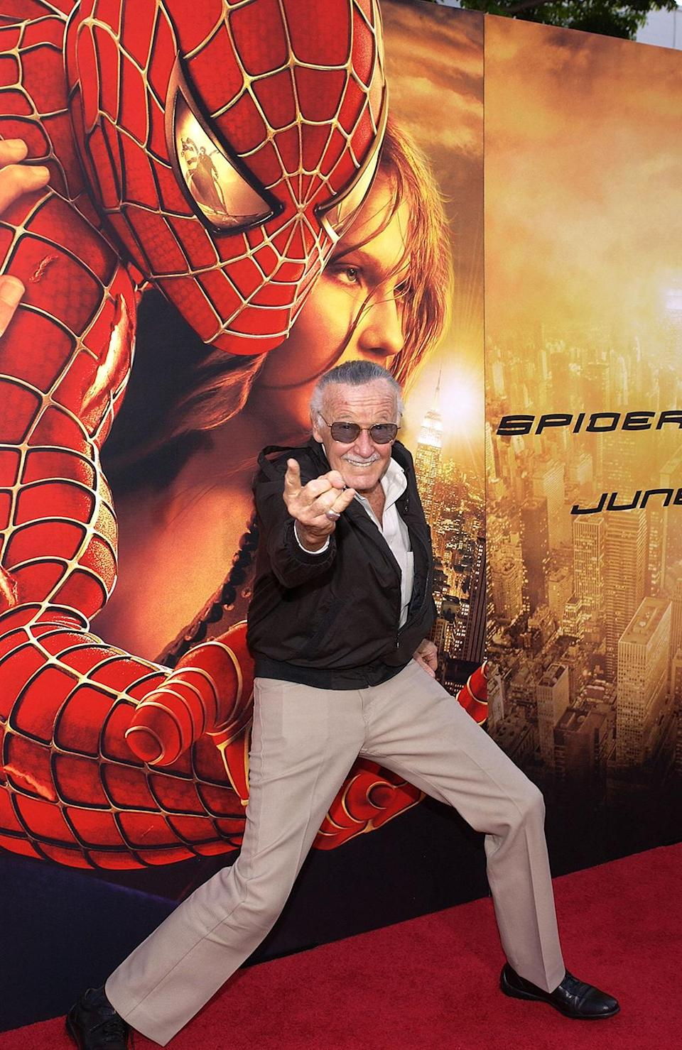 """<p><em>Spider-Man</em> co-creator Stan """"The Man"""" Lee shows off his web-throwing prowess at the <em>Spider-Man 2</em> premiere.(Photo: Vince Bucci/Getty Images) </p>"""