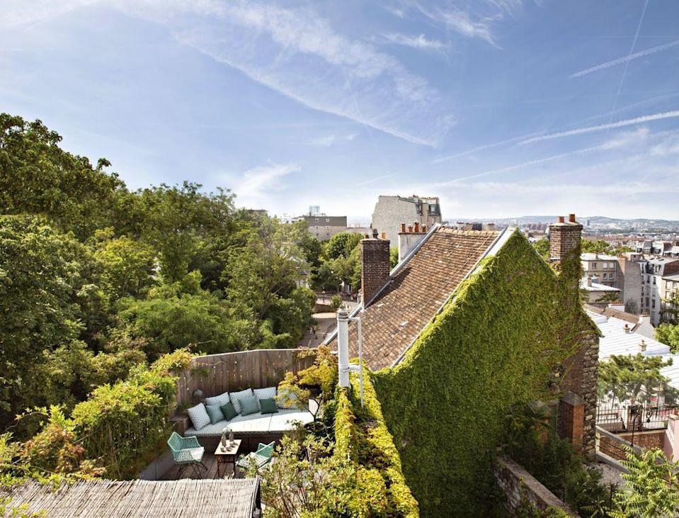 <p>Some of the best designs arise out of constraints and a good garden designer will be able to see even the most unpromising roof space, light well or alleyway with new eyes. A roomy daybed is the focus of this dinky roof terrace in Montmartre, Paris. Using the same wood for the decking as the fence makes the space seem larger, while rampant climbers and a couple of small trees create the impression of a secret garden.<br></p>