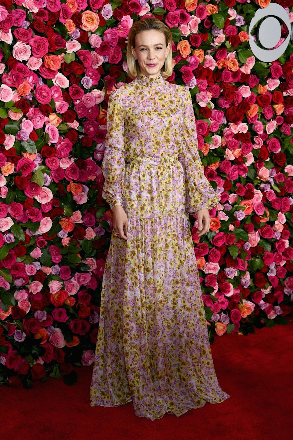 <p>Carey Mulligan made a case for covering up in a long sleeves, floor-lenth Giambattista Valli floral gown. <em>[Photo: Getty]</em> </p>