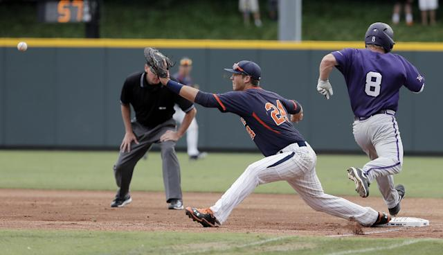 Pepperdine first baseman Brad Anderson (24) reaches for the throw as TCU's Boomer White (8) attempts to reach first during the first inning of an NCAA college baseball tournament super regional game in Fort Worth, Texas, Monday, June 9, 2014. White was called out on the play. (AP Photo/Brandon Wade)