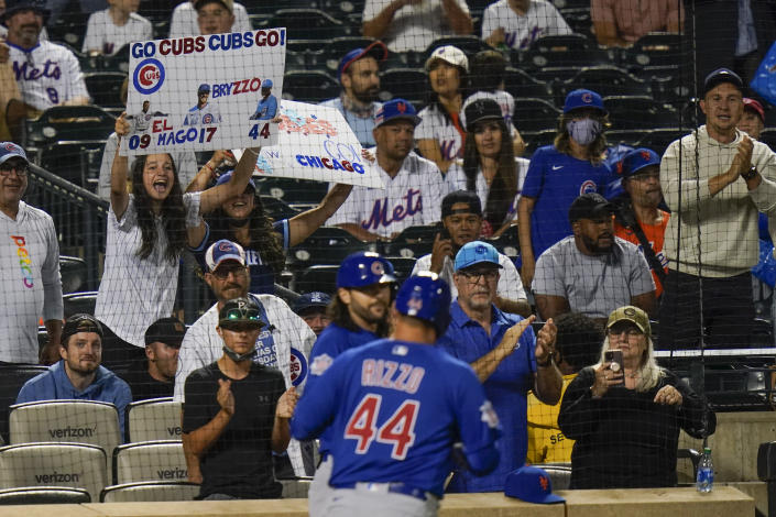 Fans cheer for Chicago Cubs' Anthony Rizzo (44) after he hit a home run during the seventh inning of a baseball game against the New York Mets, Monday, June 14, 2021, in New York. (AP Photo/Frank Franklin II)