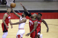 Chicago Bulls' Coby White, second from left, shoots a layup ahead of Houston Rockets' P.J. Tucker (17) during the third quarter of an NBA basketball game Monday, Feb. 22, 2021, in Houston. (Carmen Mandato/Pool Photo via AP)