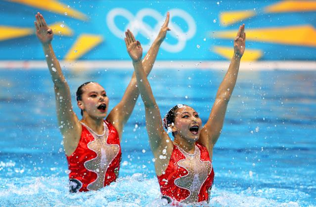 Xuechen Huang and Ou Liu of China compete in the Women's Duets Synchronised Swimming Technical Routine on Day 9 of the London 2012 Olympic Games at the Aquatics Centre on August 5, 2012 in London, England. (Photo by Clive Rose/Getty Images)