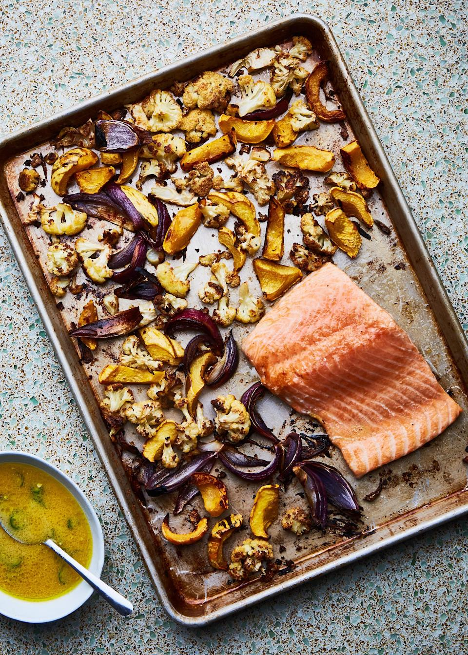 "Spiking fresh orange and lime juices with a shot of rice vinegar gives the sweet citrus flavor an edge to stand up to rich fish and earthy roasted vegetables. <a href=""https://www.bonappetit.com/recipe/sheet-pan-salmon-and-squash-with-miso-mojo?mbid=synd_yahoo_rss"" rel=""nofollow noopener"" target=""_blank"" data-ylk=""slk:See recipe."" class=""link rapid-noclick-resp"">See recipe.</a>"