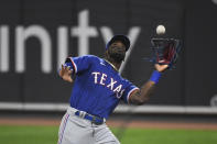 Texas Rangers right fielder Adolis Garcia catches a foul ball hit by Baltimore Orioles' Austin Hays during the third inning of a baseball game Thursday, Sept. 23, 2021, in Baltimore. (AP Photo/Terrance Williams)