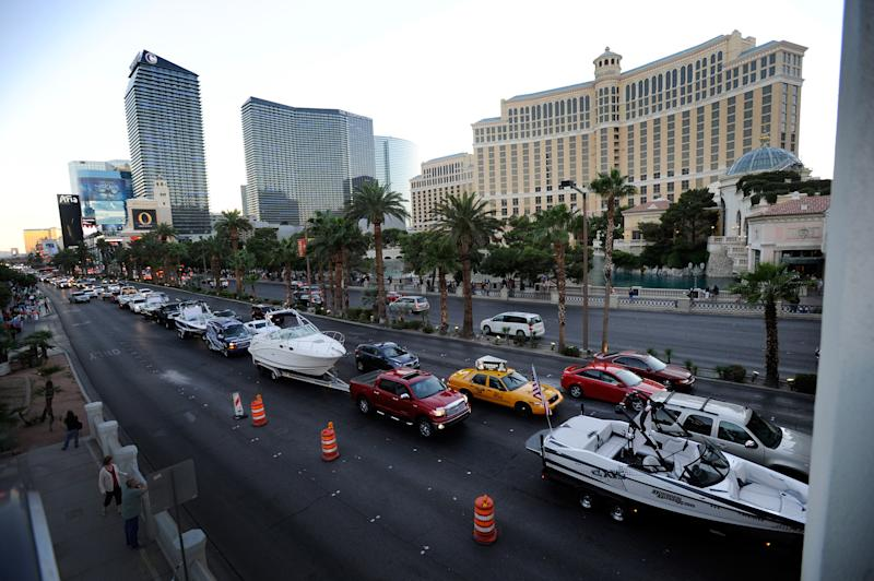 "A procession of boats are towed up the Las Vegas Strip protesting the closure of the Lake Mead National Recreation Area on Sunday, Oct. 6, 2013. Several dozen boaters joined together to ""peacefully cruise"" from Tropicana to Sahara avenues as an expression of their frustrations to Congress with the continual government shutdown causing the closure all national parks including Lake Mead. (AP Photo/Las Vegas Review-Journal, David Becker) LOCAL TV OUT; LOCAL INTERNET OUT; LAS VEGAS SUN OUT MBO"