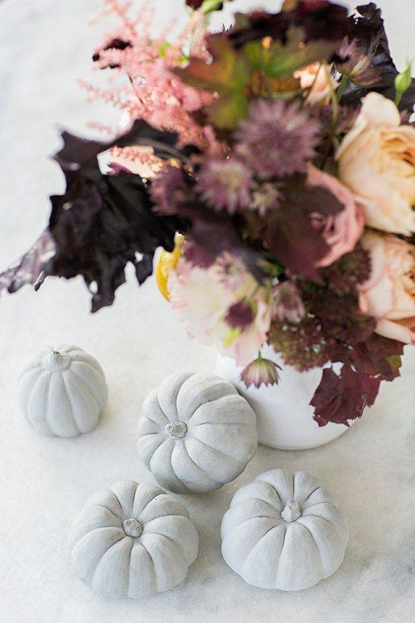 "<p>Opt for pinks, peaches, and burgundies in your centerpiece rather than the classic warm orange-y fall palette. Then paint your pumpkins a neutral hue! (Faux pumpkins work, too.)</p><p><a class=""link rapid-noclick-resp"" href=""https://www.amazon.com/dp/B07DXJYTDH/ref=sspa_dk_detail_2?psc=1&pd_rd_i=B07DXJYTDH&pd_rd_w=WBv0f&pf_rd_p=7d37a48b-2b1a-4373-8c1a-bdcc5da66be9&pd_rd_wg=8pCEx&pf_rd_r=3HPJ5PPQB68BXBRVR93V&pd_rd_r=787393d8-cc5f-4290-8a7b-391f04d1a31a&spLa=ZW5jcnlwdGVkUXVhbGlmaWVyPUEzNTU0QUg3Skg5MlQwJmVuY3J5cHRlZElkPUEwODUwMzMwMlpCM0UzSU5GT1NUNCZlbmNyeXB0ZWRBZElkPUEwMjUwMjk4MzVUQ1JHT0Y5U0dHTSZ3aWRnZXROYW1lPXNwX2RldGFpbCZhY3Rpb249Y2xpY2tSZWRpcmVjdCZkb05vdExvZ0NsaWNrPXRydWU%3D&tag=syn-yahoo-20&ascsubtag=%5Bartid%7C10057.g.2554%5Bsrc%7Cyahoo-us"" rel=""nofollow noopener"" target=""_blank"" data-ylk=""slk:BUY NOW"">BUY NOW</a> <strong><em>Small Artificial Pumpkin, $14</em></strong></p>"