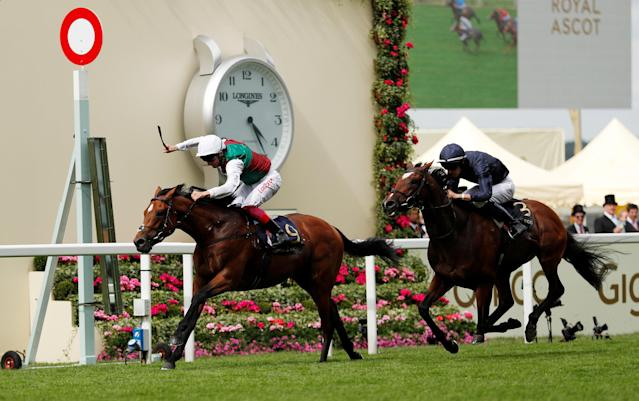 Horse Racing - Royal Ascot - Ascot Racecourse, Ascot, Britain - June 19, 2018 Without Parole ridden by Frankie Dettori in action as he wins the 4.20 St James's Palace Stakes Action Images via Reuters/Andrew Boyers