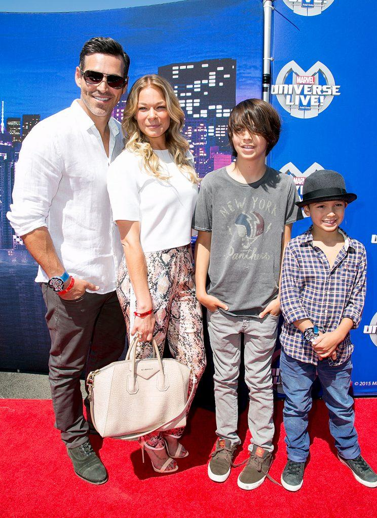 Eddie Cibrian with LeAnn Rimes and his children Mason and Jake attend Marvel Universe LIVE! Celebrity premiere.