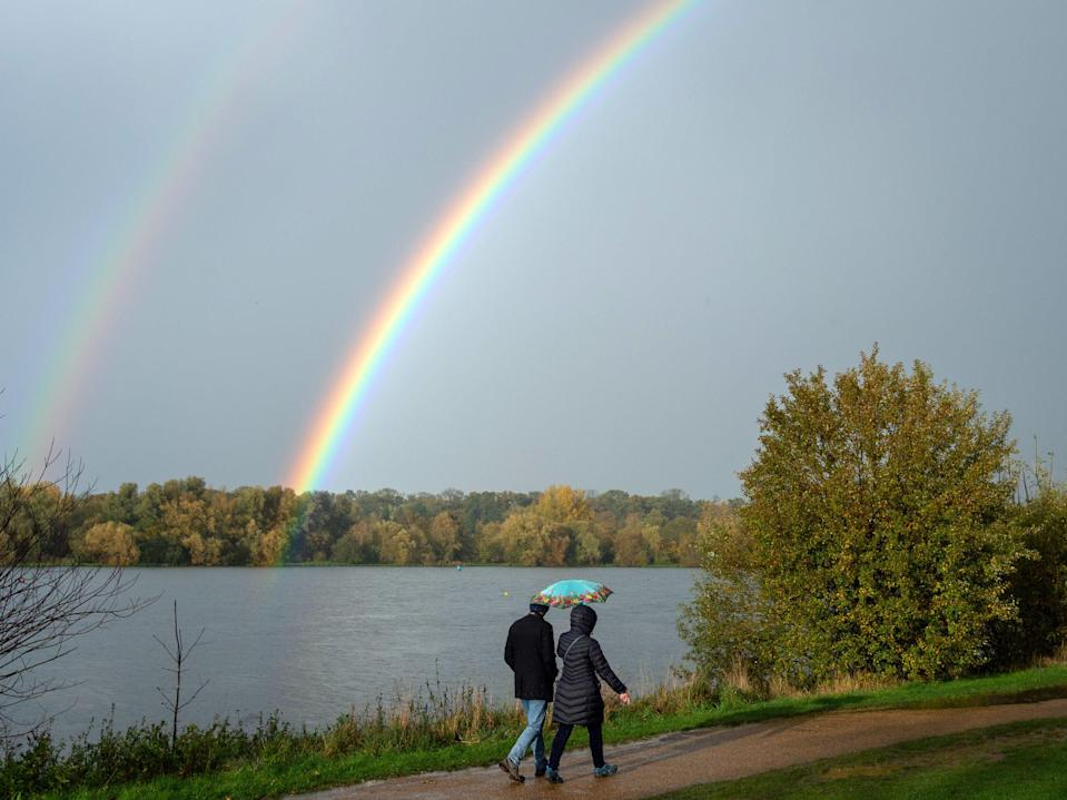 A double rainbow appears after a heavy rain shower at Nene Park in Peterboroug (PA)