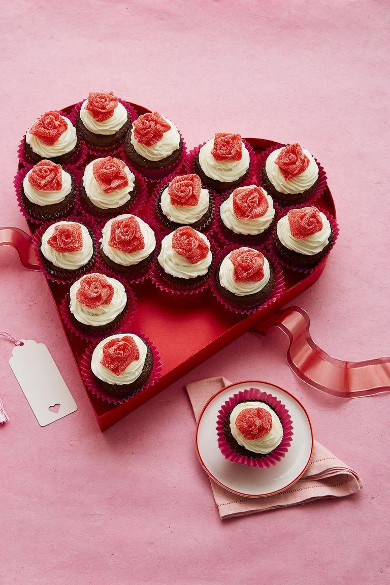 """<p>An ode to your relationship, this recipe balances the chocolatey sweetness with a bite of sour flavor.</p><p><em><a href=""""https://www.womansday.com/food-recipes/food-drinks/recipes/a61055/mini-rosebud-cupcakes-recipe/"""" rel=""""nofollow noopener"""" target=""""_blank"""" data-ylk=""""slk:Get the recipe from Woman's Day »"""" class=""""link rapid-noclick-resp"""">Get the recipe from Woman's Day »</a></em></p>"""