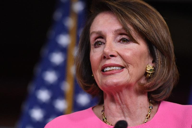 A manipulated video purporting to show a slurring Nancy Pelosi, pictured this month, was gaining traction on social media with millions of shares Friday, as the Democratic congressional leader traded insults with President Donald Trump over mental health