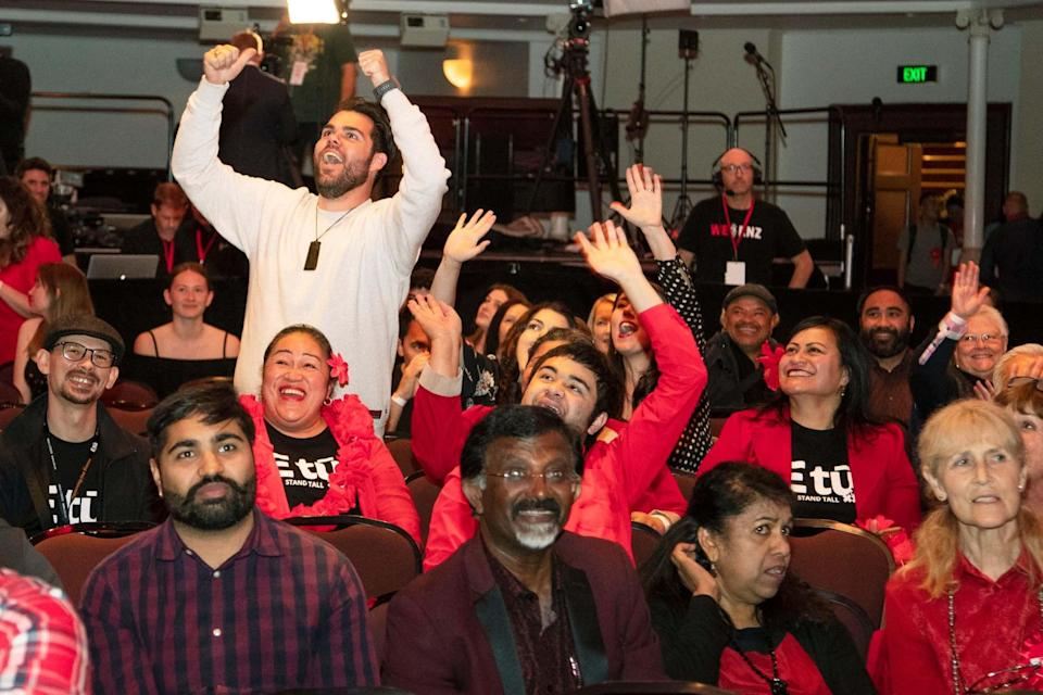 New Zealand Labour Party supporters react as results are showed on a screen at a party event after the polls closed in Auckland (AP)