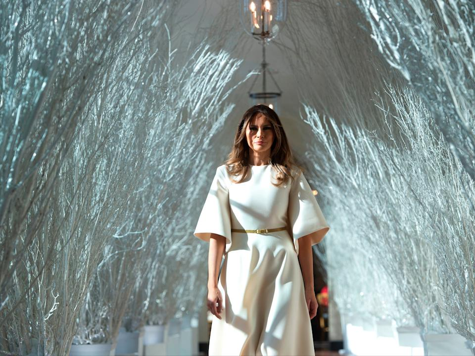 First Lady Melania Trump walks through Christmas decorations in the East Wing, 27 November 2017AFP via Getty Images