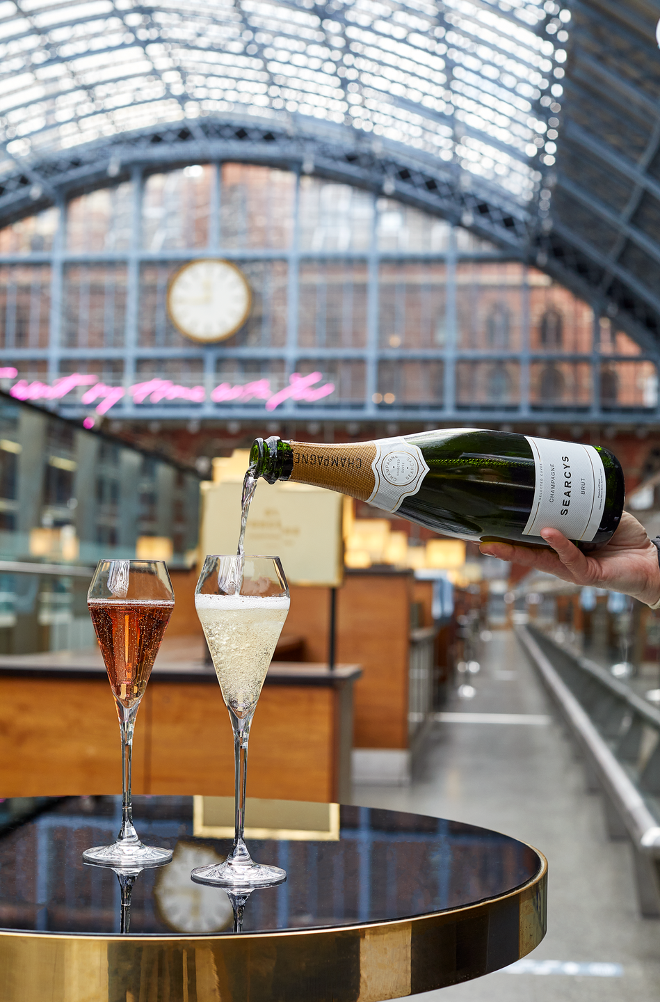 """<p><strong>Happy hour deal:</strong></p><p>The St Pancras champagne bar - found inside the station - is currently offering '4 O'Clocksies', available from 4-6pm. You'll get two glasses of Searcy's Selected Cuvée Champagne with four delicious savoury bites, including Rarebit; Salt beef and piccalilli brioche bun; Creedy Carver chicken pie and Celtic prawn cocktail bridge roll for £29 for two people<br></p><p>Find out more <a href=""""https://stpancrasbysearcys.co.uk/"""" rel=""""nofollow noopener"""" target=""""_blank"""" data-ylk=""""slk:here"""" class=""""link rapid-noclick-resp"""">here</a>.</p>"""