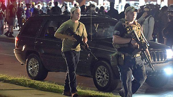 PHOTO: Kyle Rittenhouse, center, with cap on backwards, walks along Sheridan Road in Kenosha, Wis., Aug. 25, 2021, with another armed civilian. (Adam Rogan/AP)