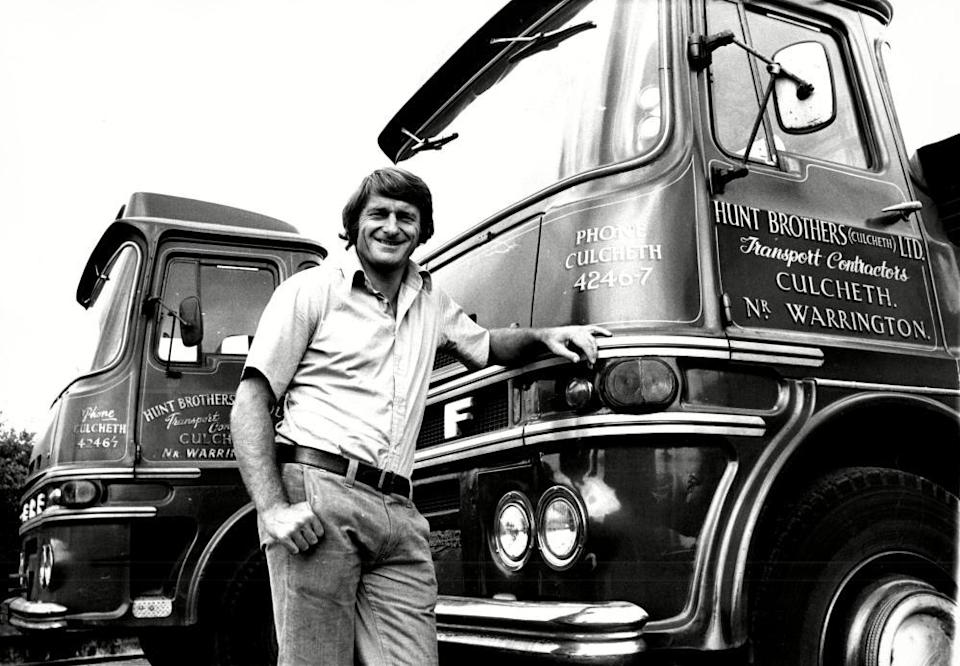 Roger Hunt poses with a few of the trucks in the yard at his family's haulage business in Culcheth, Warrington.