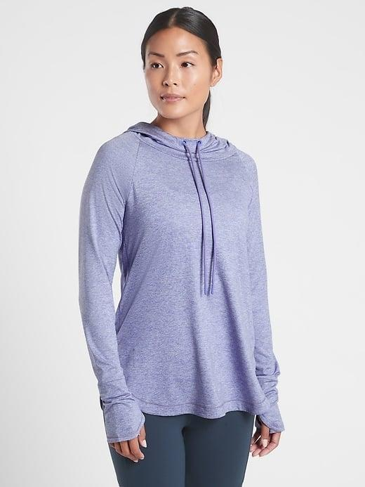 <p>This soft <span>Athleta Uptempo Hoodie Sweatshirt</span> ($79) can add a little something to a chilly day (or studio workout).</p>