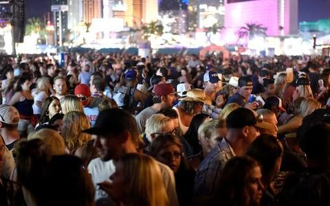<span>A crowd of people at the Route 91 Harvest festival</span> <span>Credit: David Becker/Getty </span>