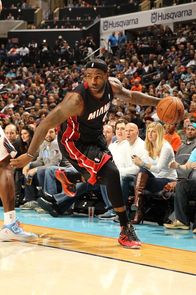 CHARLOTTE, NC - NOVEMBER 16: LeBron James #6 of the Miami Heat looks to pass the ball against the Charlotte Bobcats during the game at the Time Warner Cable Arena on November 16, 2013 in Charlotte, North Carolina. (Photo by Kent Smith/NBAE via Getty Images)