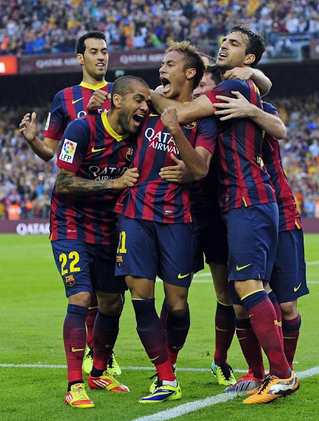 FC Barcelona's Neymar, third left, reacts after scoring against Real Madrid with his teammates Cesc Fabregas, right, Lionel Messi, second right, Daniel Alves, second left, and Sergio Busquets, left, during a Spanish La Liga soccer match at the Camp Nou stadium in Barcelona, Spain, Saturday, Oct. 26, 2013. (AP Photo/Manu Fernandez)