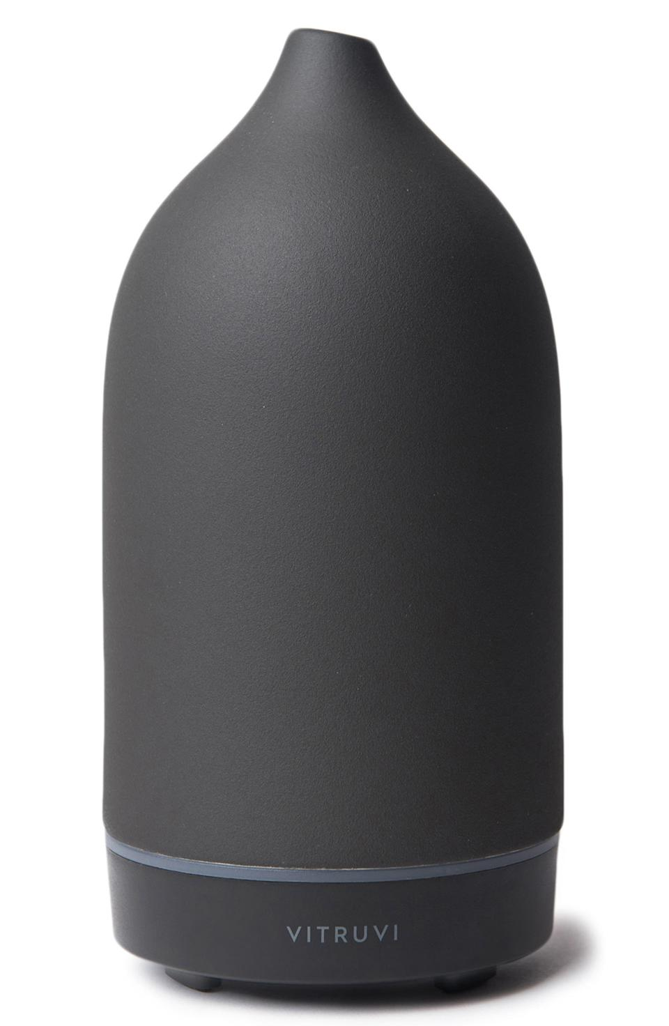 """<h3>Vitruvi Stone Diffuser </h3><br><br>There are so many diffusers out there, but this one has safety features, and is produced cruelty free. As a bonus, it's super cute from an interior design standpoint. Although there isn't enough conclusive research, Mayo Clinic notes that <a href=""""https://www.refinery29.com/en-us/aromatherapy-products-for-sleep"""" rel=""""nofollow noopener"""" target=""""_blank"""" data-ylk=""""slk:aromatherapy"""" class=""""link rapid-noclick-resp"""">aromatherapy</a> may have positive benefits such as <a href=""""https://www.mayoclinic.org/healthy-lifestyle/consumer-health/expert-answers/aromatherapy/faq-20058566"""" rel=""""nofollow noopener"""" target=""""_blank"""" data-ylk=""""slk:relief from anxiety"""" class=""""link rapid-noclick-resp"""">relief from anxiety</a> and improved sleep.<br><br>I use mine with a <a href=""""https://vitruvi.com/products/dusk-essential-oil-blend?variant=5015421648924&gclid=EAIaIQobChMI88LumYiQ5AIVCiaGCh0i7wdDEAQYASABEgJ97PD_BwE"""" rel=""""nofollow noopener"""" target=""""_blank"""" data-ylk=""""slk:Vitruvi essential oil blend called Dusk"""" class=""""link rapid-noclick-resp"""">Vitruvi essential oil blend called Dusk</a>, which is frankincense, eucalyptus, ho wood, and lavender. I keep it in my room, and I turn it on and close my door after particularly long days at work. It makes me feel as reborn as a caterpillar in a tiny, heavenly smelling cocoon of peace.<br><br><strong>Vitruvi</strong> Porcelain Essential Oil Diffuser, $, available at <a href=""""https://go.skimresources.com/?id=30283X879131&url=https%3A%2F%2Fshop.nordstrom.com%2Fs%2Fvitruvi-porcelain-essential-oil-diffuser%2F4632548"""" rel=""""nofollow noopener"""" target=""""_blank"""" data-ylk=""""slk:Nordstrom"""" class=""""link rapid-noclick-resp"""">Nordstrom</a>"""