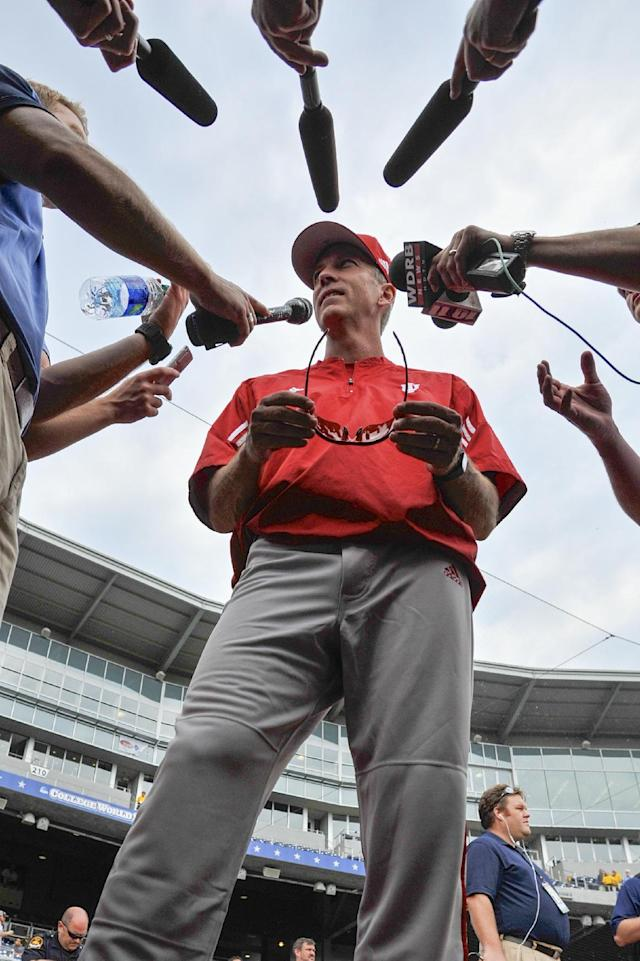 FILE - In this June 14, 2013, file photo, Indiana coach Tracy Smith talks to reporters during NCAA college baseball practice at TD Ameritrade Park in Omaha, Neb. Coming off its first College World Series appearance, Indiana started just 12-10 and has had two pitchers go out with season-ending injuries. Now, with a month left in the regular season, the Big Ten-leading Hoosiers have won 13 of their last 14 games. (AP Photo/Eric Francis)