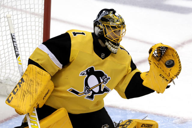 Pittsburgh Penguins goaltender Casey DeSmith gloves a shot during the first period of an NHL hockey game against the New York Rangers in Pittsburgh, Sunday, Feb. 17, 2019. (AP Photo/Gene J. Puskar)