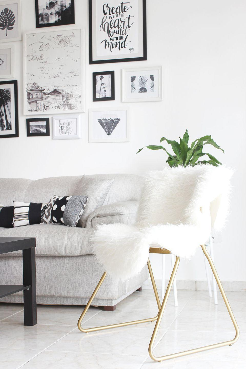 """<p>Even something as simple as spray painting the silver to gold and throwing on some cute faux fur, like Nathalia of The Key Item, it looks instantly more expensive and chic!</p><p>See more at <a href=""""https://www.thekeyitem.com/blog/es/2016/09/diy-ikea-hack-silla-glamurosa?rq=ikea"""" rel=""""nofollow noopener"""" target=""""_blank"""" data-ylk=""""slk:The Key Item"""" class=""""link rapid-noclick-resp"""">The Key Item</a>.</p><p><a class=""""link rapid-noclick-resp"""" href=""""https://go.redirectingat.com?id=74968X1596630&url=https%3A%2F%2Fwww.ikea.com%2Fus%2Fen%2Fp%2Frens-sheepskin-white-70026822%2F&sref=https%3A%2F%2Fwww.bestproducts.com%2Fhome%2Fg29514474%2Fbest-ikea-hacks%2F"""" rel=""""nofollow noopener"""" target=""""_blank"""" data-ylk=""""slk:BUY NOW"""">BUY NOW</a> <strong><em>RENS</em></strong><strong><em> Rug, $30, ikea.com</em></strong></p>"""