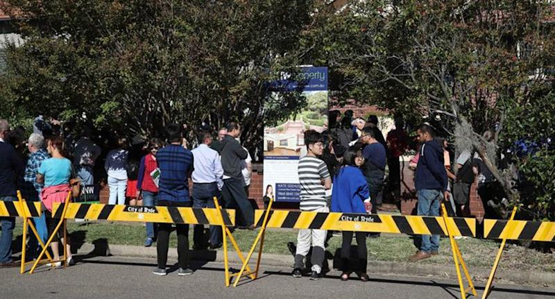 A crowd of almost 300 turned up to watch the notorious Epping property sell. Source: Sunday Telegraph