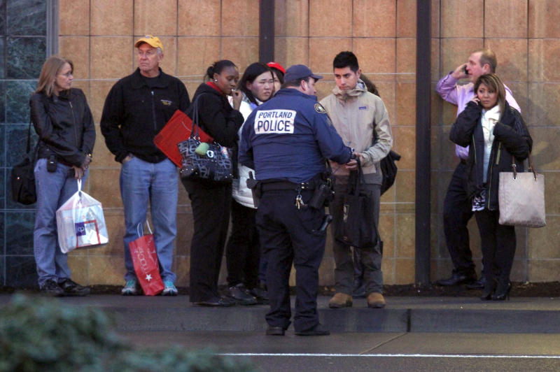 A police officer conducts interviews with mall patrons outside the Clackamas Town Center in Clackamas, Ore. Tuesday, Dec. 11, 2012. A gunman is dead after opening fire in the Portland, Ore., area shopping mall Tuesday, killing two people and wounding another, sheriff's deputies said. (AP Photo/The Oregonian, Bruce Ely) MAGS OUT; TV OUT; LOCAL TV OUT; LOCAL INTERNET OUT; THE MERCURY OUT; WILLAMETTE WEEK OUT; PAMPLIN MEDIA GROUP OUT
